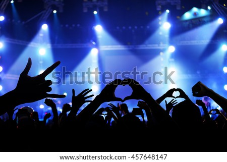 Silhouette of a crowd of cheering fans during a live concert, live music concert #457648147
