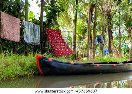Backwaters in Kerala, India. Beautiful scene from an old Indian village  #457659637