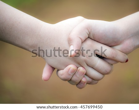 Two woman with handshake #457699450