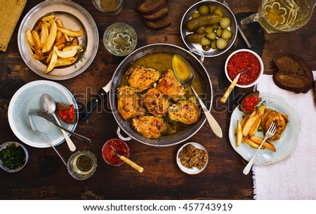 Roasted chicken with fried potato and green chili pepper chutney, marinated cucumber, white wine. Dinner table party. #457743919