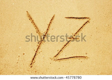 Concept or conceptual abstract set or collection of fonts in sand on exotic beach sea shore handwritten in a sandy texture background in summer for alphabet,education,letter,text,vacation or tourism #45778780