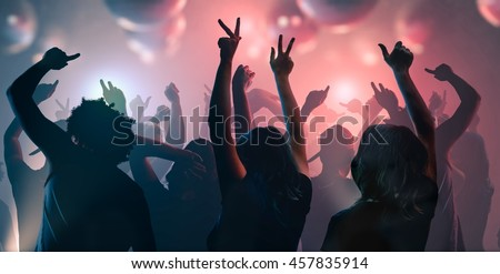 Nightlife and disco concept. Young people are dancing in club. #457835914