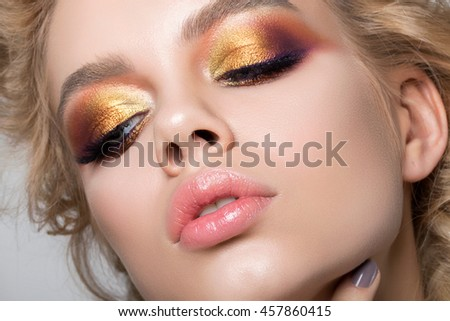 Close up beauty portrait of young woman with beautiful summer bright makeup. Modern smokey eyes with colorful metallic eyeshadows. Studio shot #457860415