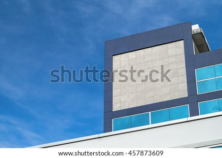 Mockup Company logo or signage, blank space Granite Texture on building in the city.