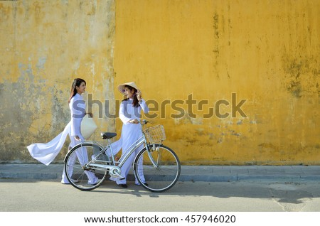 Beautiful  woman with Vietnam culture traditional ,vintage style,Hoi an Vietnam Royalty-Free Stock Photo #457946020