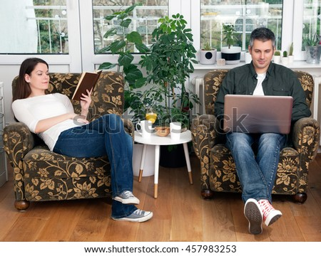 Young couple in a living room #457983253