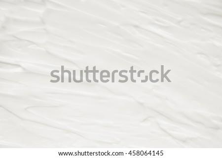 Cosmetics. Cream white background texture. #458064145