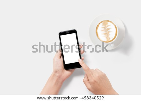 Design concept of mockup using smartphone and coffee set isolated on white background. Clipping Path included on white background. Copyspace for your text. #458340529
