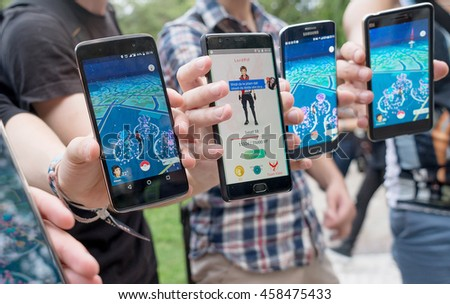 Pokemon GO augmented reality smartphone game players and trainers play together in the park while in attempt to catch all the pokemons, Plovdiv, Bulgaria, July 24, 2016. #458475433