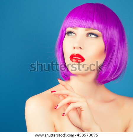 beautiful woman wearing colorful wig against blue background #458570095