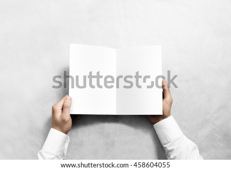 Hand opening blank white brochure booklet mockup. Leaflet presentation. Pamphlet mock up holding hand. Man show clear offset paper. Booklet design template. A5 paper sheet display read first person #458604055