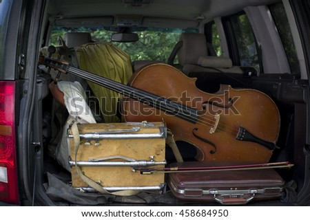 A car trunk loaded with cello and artist equipment, outdoor cropped shot #458684950