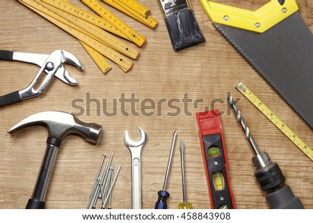 Assorted work tools on wood #458843908