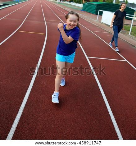 Little girl have fun on the stadium #458911747