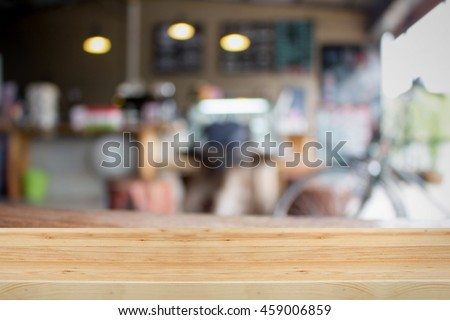 Wooden table for present product with Coffee shop blur background made with Vintage Tones. #459006859