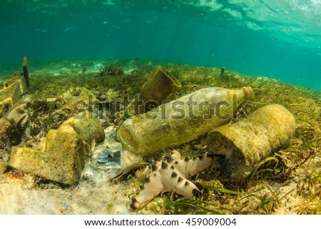 Plastic bottles and rubbish pollution in ocean Royalty-Free Stock Photo #459009004