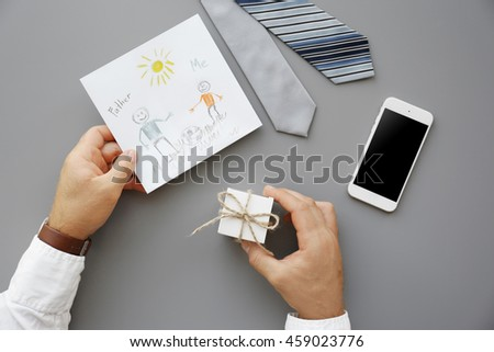 Happy Father's Day concept. Presents for father on grey background