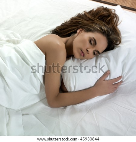 beautiful caucasian woman sleeping on a white bed #45930844