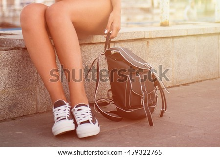 closeup of woman legs in white gumshoes, outdoor shot #459322765