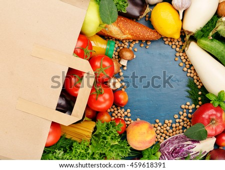 Paper bag with food on blue surface with copy space, top view #459618391