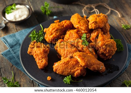 Spicy Deep Fried Breaded Chicken Wings with Ranch Royalty-Free Stock Photo #460012054