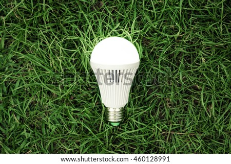 A turned on LED light bulb / Green energy concept / Using environmentally friendly appliances concept #460128991