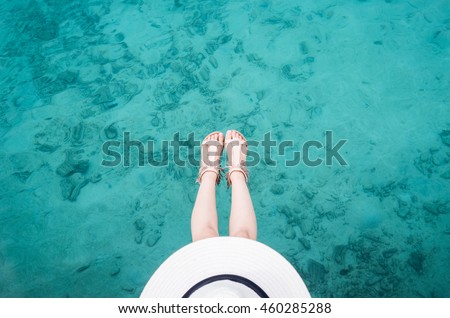 adult woman relax chilling sit over clear aqua blue sea ocean in Maldives beach for vacation on her chilled holiday. Life style of teeager.