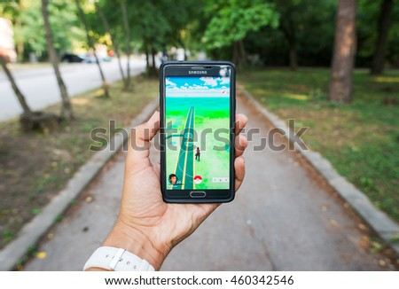 Pokemon GO ios and android smartphone game in the park exploring for pokemons, Sofia, Bulgaria, July 28, 2016. #460342546