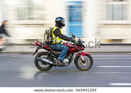 Man riding motorcycle #460445389