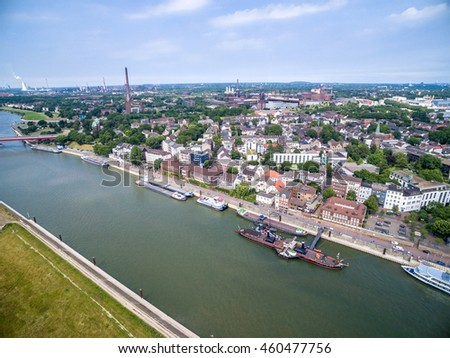 DUISBURG / GERMANY - JULY 29 2016 : Duisburg Ruhrort und the sun, aerial #460477756