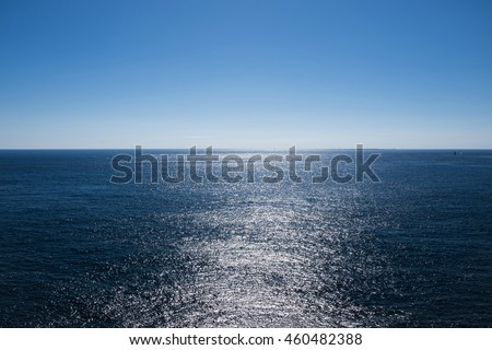 Light reflection on sea surface looking towards horizon / View of horizon at Atlantic ocean at Brittany, France Royalty-Free Stock Photo #460482388