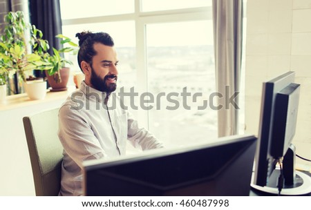 business, startup and people concept - happy businessman or creative male office worker with computer #460487998
