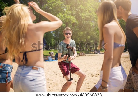 Man taking a photo of his friends