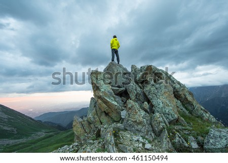 man on top of a mountain at sunset in summer #461150494