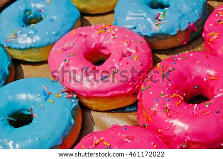 sweet donuts are decorated with colorful icing.  icing sugar food. Dessert snack. #461172022
