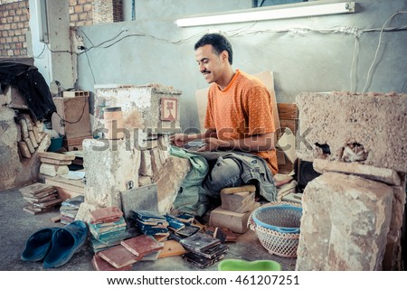 FEZ, MOROCCO, JUNE 2016: traditional pottery worker on the streets in the old Medina #461207251