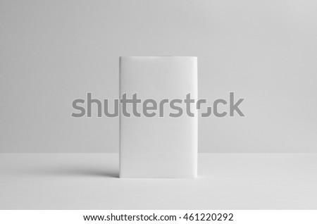 Hardcover Book Mock-Up - Dust Jacket. Backside. Wall Background Royalty-Free Stock Photo #461220292