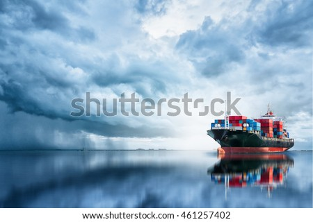 International Container Cargo ship in the ocean, Freight Transportation, Shipping, Nautical Vessel Royalty-Free Stock Photo #461257402