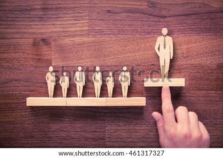 Successful team leader (manager, CEO, market leader) and another business leading concepts. Standing out from the crowd. Royalty-Free Stock Photo #461317327