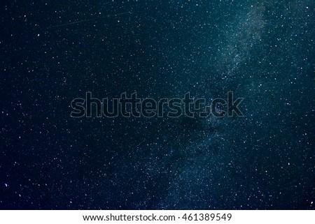 Starry sky, the Milky Way galaxy, airplane vapor trail.
