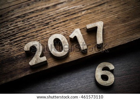 old 2016 and New happy 2017 Year made from wooden numbers lie on wooden table background. Different levels #461573110