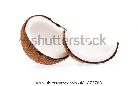 Old brown organic coconut fruit copra broken into pieces and stacked on white background #461673703