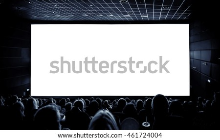 Cinema. The audience in 3D glasses watching a movie. A white screen for your image. Royalty-Free Stock Photo #461724004