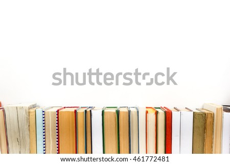 Stack of colorful books, grungy white background, free copy space Vintage old hardback books on wooden shelf on the deck table, no labels, blank spine. Back to school. Education background #461772481