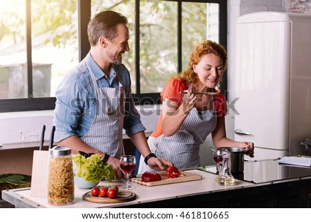 Woman trying a dish cooked with husband #461810665