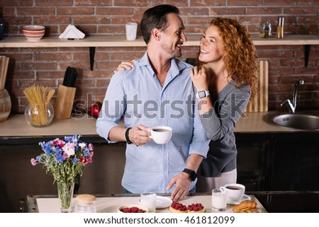 Woman embracing man in the kitchen #461812099