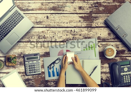 Top view of Business still life on old wooden table background. Vintage tone with Copy Space #461899099
