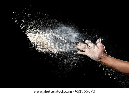 Hand and flour on black background #461965870
