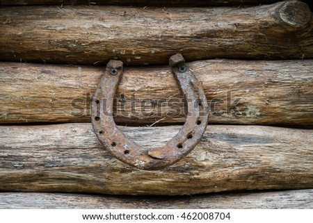 Old rusty horseshoe on vintage wooden board #462008704