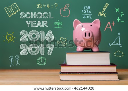 School year 2016-2017 with pink piggy bank infront of a chalkboard